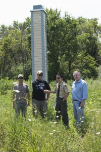 From left: Ryan Campbell (FESS), Benjamin Haberthur (Veterans Conservation Corps of Chicagoland), scout Theo Li and Dave Shemanske (FESS) stand in front of one of three chimney swift towers built by Boy Scout Troop 3 on Fermilab grounds. Photo: Ali Sundermier, OC