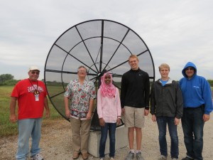 This group is building an 8-foot radio telescope as part of the QuarkNet program at Fermilab. From left: Edward Dijak (PPD), Chris Stoughton (PPD), Saniya Qadir (Wheaton North HS), Jake Johanik (home school), Maciej Mleczko (Wheaton Warrenville South High School) and George Dzuricsko (WDRS). Not pictured: Ben Sawyer (teacher at Wheaton Academy) and Albert Stebbins (PPD). Photo: Lauren Craig, WDRS