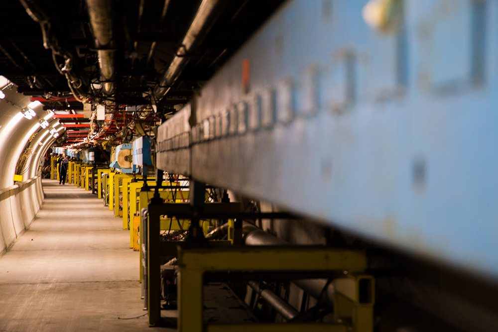 The Fermilab photo club tours the decommissioned Tevatron. The tunnels hold a rich history of advances in particle physics. Photo: Rashmi Shivni, OC