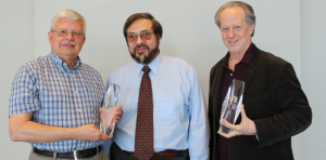 "US Particle Accelerator School Director Bill Barletta (center) presents Don Cossairt of ESH&Q (left) and Mike Syphers of Northern Illinois University and Fermilab (right) with the first USPAS ""Iron Man"" service recognition awards. Photo courtesy of Irina Novitski, AD"