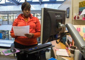 Cara Brown of WDRS reads resumes of potential Fermilab hires. Photo: Rashmi Shivni
