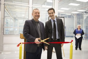 Fermilab Director Nigel Lockyer, left, and Lab 2 Project Manager Sam Posen cut the ceremonial ribbon to mark the completion of the renovation of Lab 2 on Jan. 15. Photo: Reidar Hahn