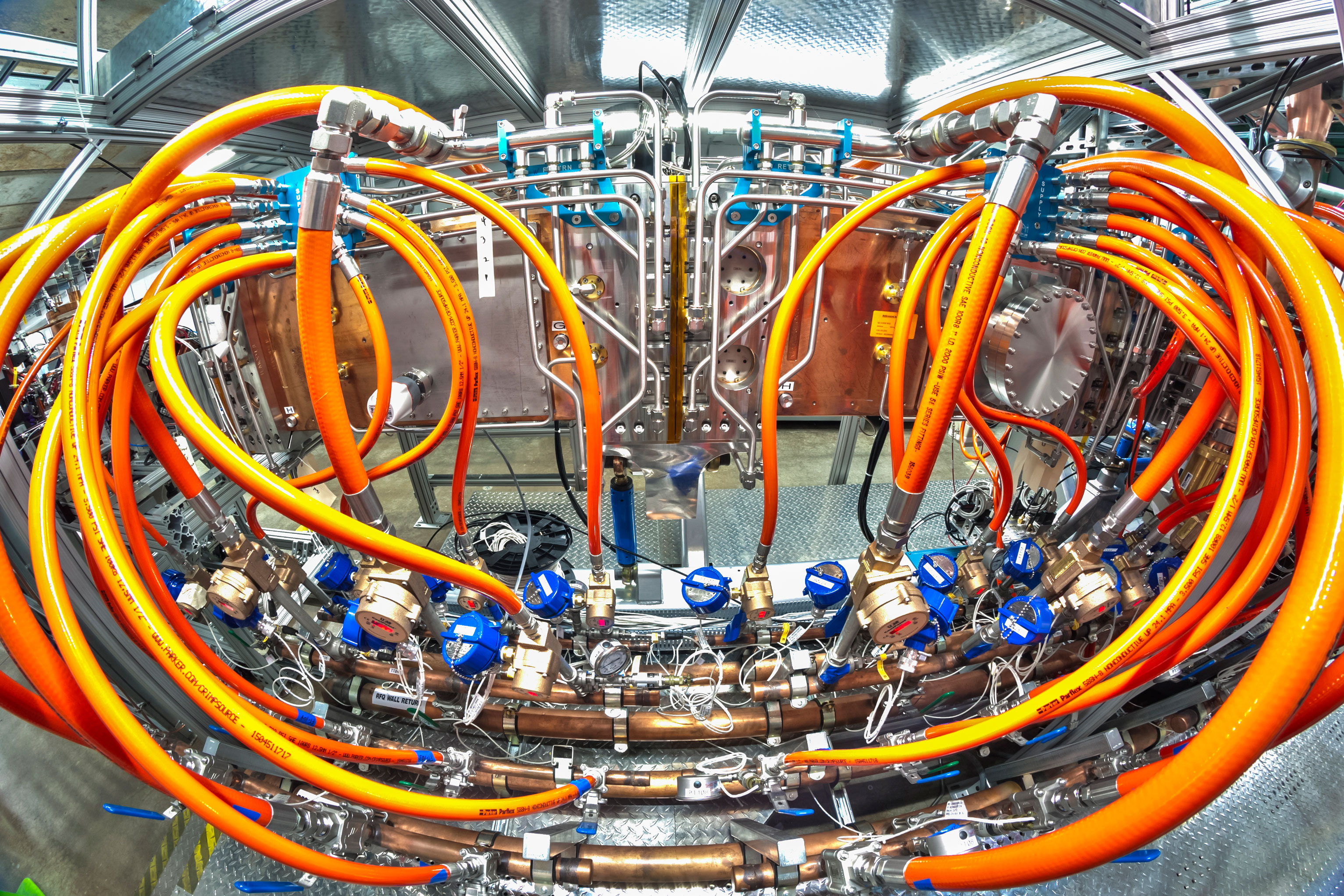 This is the radio-frequency quadrupole accelerator for PXIE, a test accelerator that prototypes the front end of the proposed PIP-II upgrades to the Fermilab accelerator complex, and its water cooling manifolds and hoses.  PXIE is located at the Cryomodule Test Facility. The Accelerator Division is currently preparing PXIE for full-time operation. Photo: Marty Murphy, AD