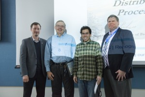 "Jeff L. Andresen (second from left, retired), Ryan Rivera (third from left, SCD) along with John Chramowicz and Alan Prosser (both of SCD, not pictured) receive recognition for their patent ""Distributed Data Acquisition and Processing System and Method,"" patent #8,898,216, issued Nov. 25, 2014. Photo: Al Johnson"