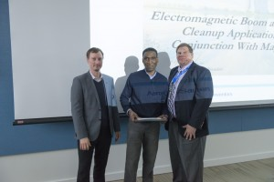 "Scientist Arden Warner, AD, receives recognition for his patent, ""Electromagnetic Boom and Environmental Cleanup Application For Use In Conjunction With Magnetizable Oil"", patent #8,795,519, issued Aug. 5, 2014. Photo: Al Johnson"