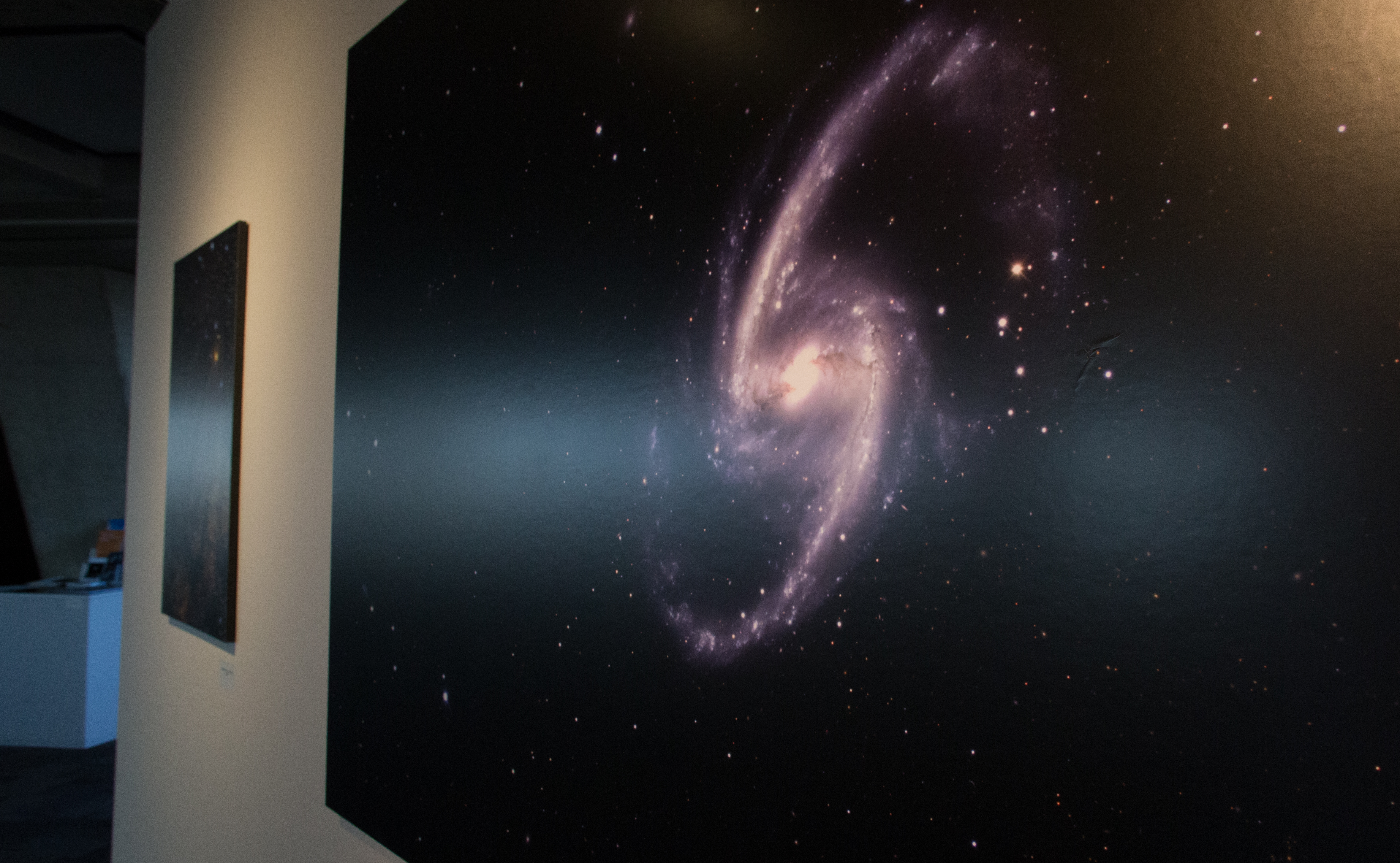"Nikolay Kuropatkin, Marty Murphy, Brian Nord and Brian Yanny created this photo of a galaxy, currently on display as part of the ""Art of Darkness"" exhibit in the Fermilab Art Gallery. A reception takes place on March 18 from 5-7 p.m. Photo of the photo: Rashmi Shivni"