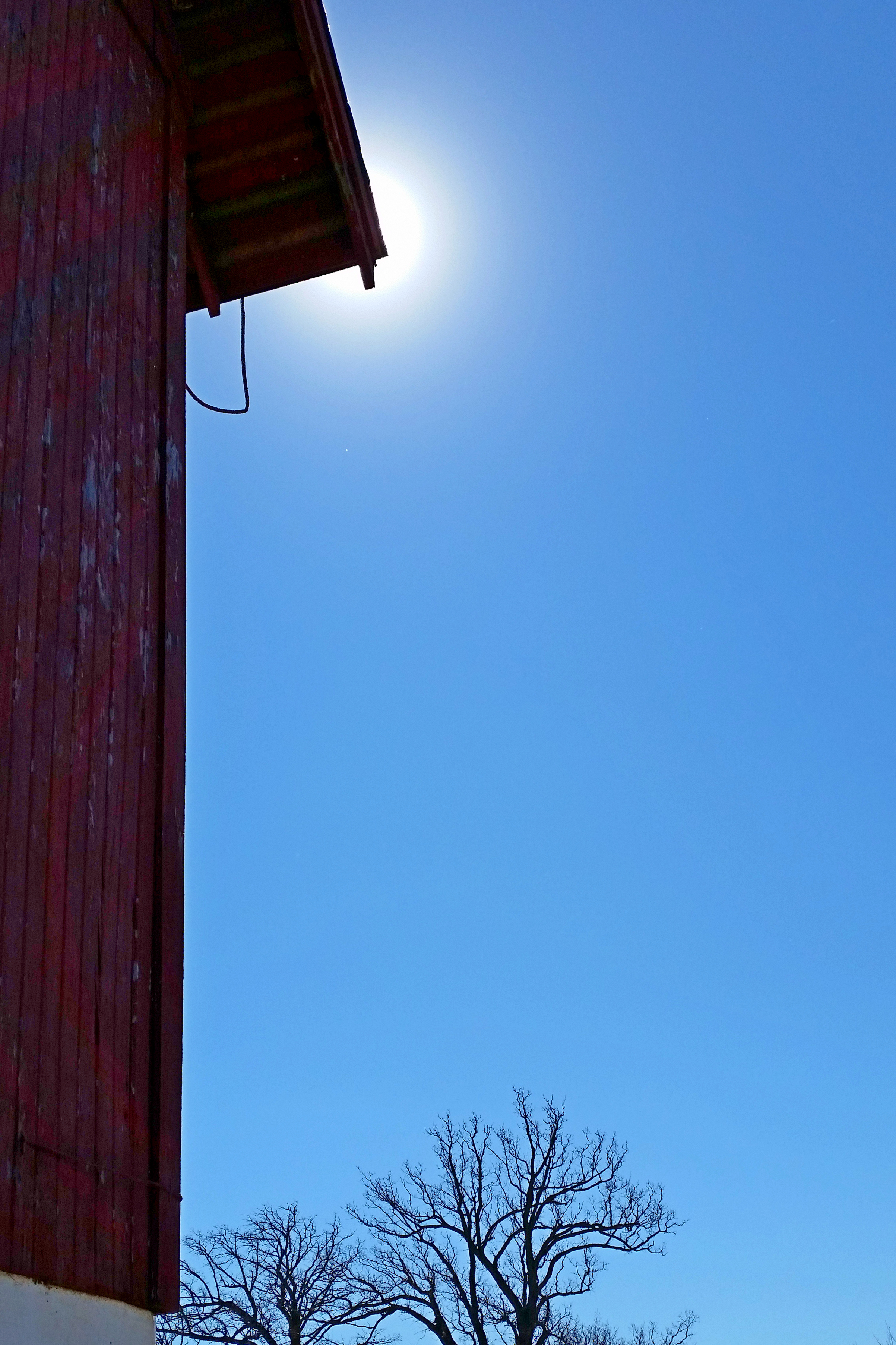 The cornice of the red barn near FZero makes contact with the center of the sun. Photo: Elliott McCrory, AD