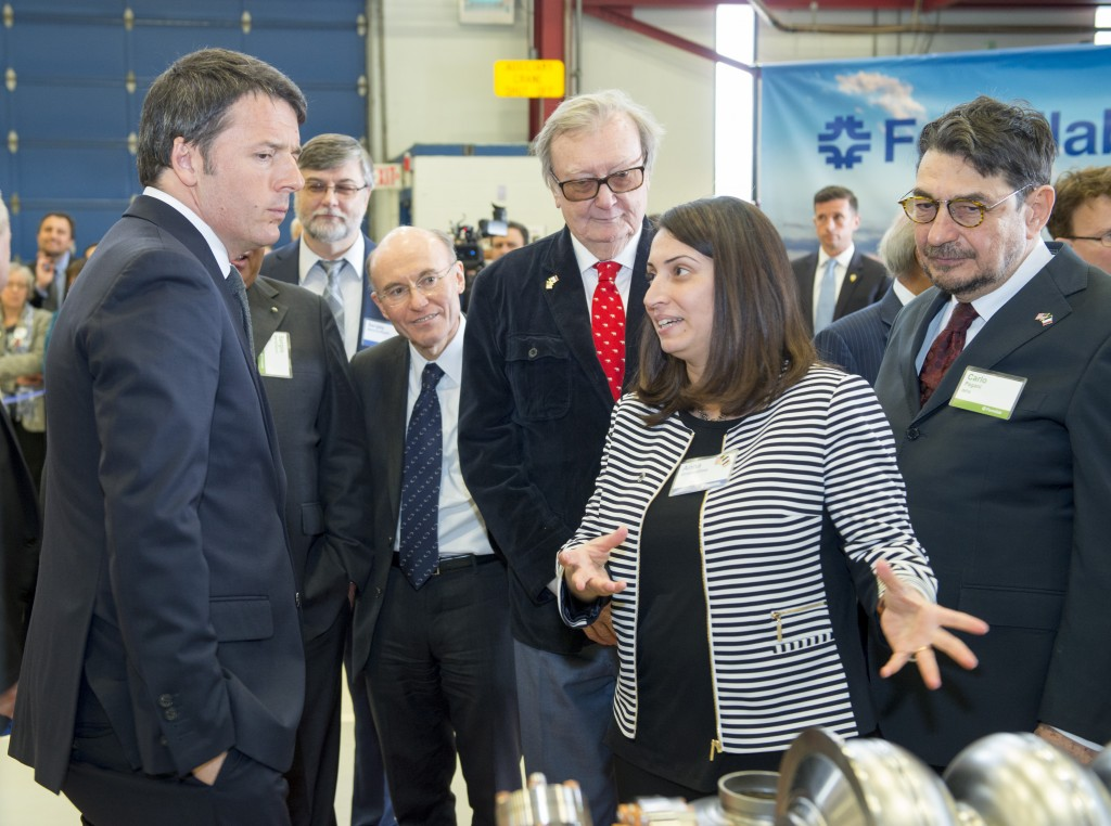 Fermilab scientist Anna Grassellino explains accelerator technology on display at the laboratory's Technical Campus to Italian Prime Minister Matteo Renzi. Photo: Fermilab
