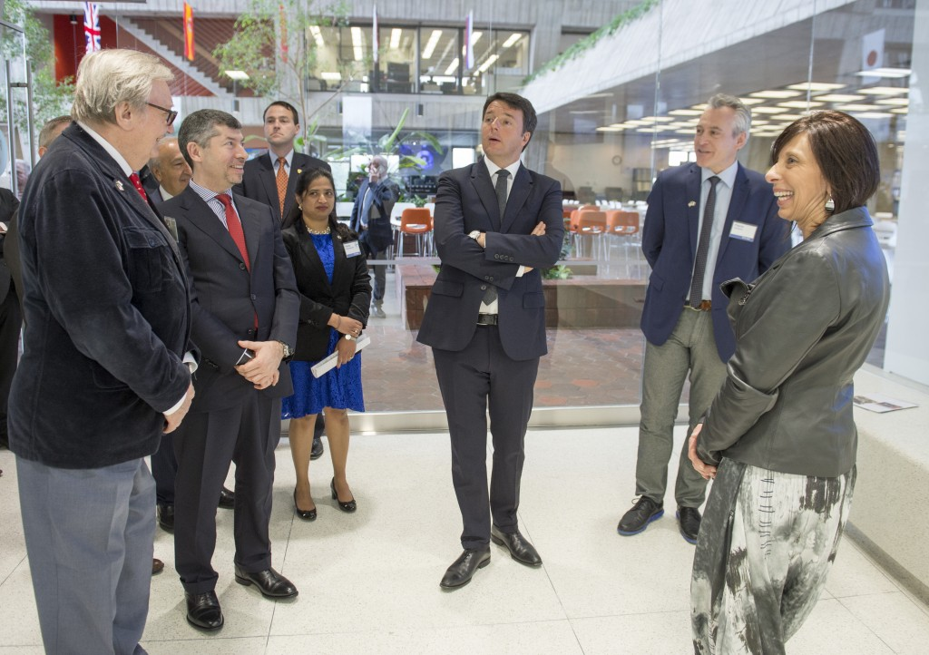 Italian Prime Minister Matteo Renzi (center) tours the Remote Operations Center West at Fermilab and learns about neutrinos. Photo: Fermilab