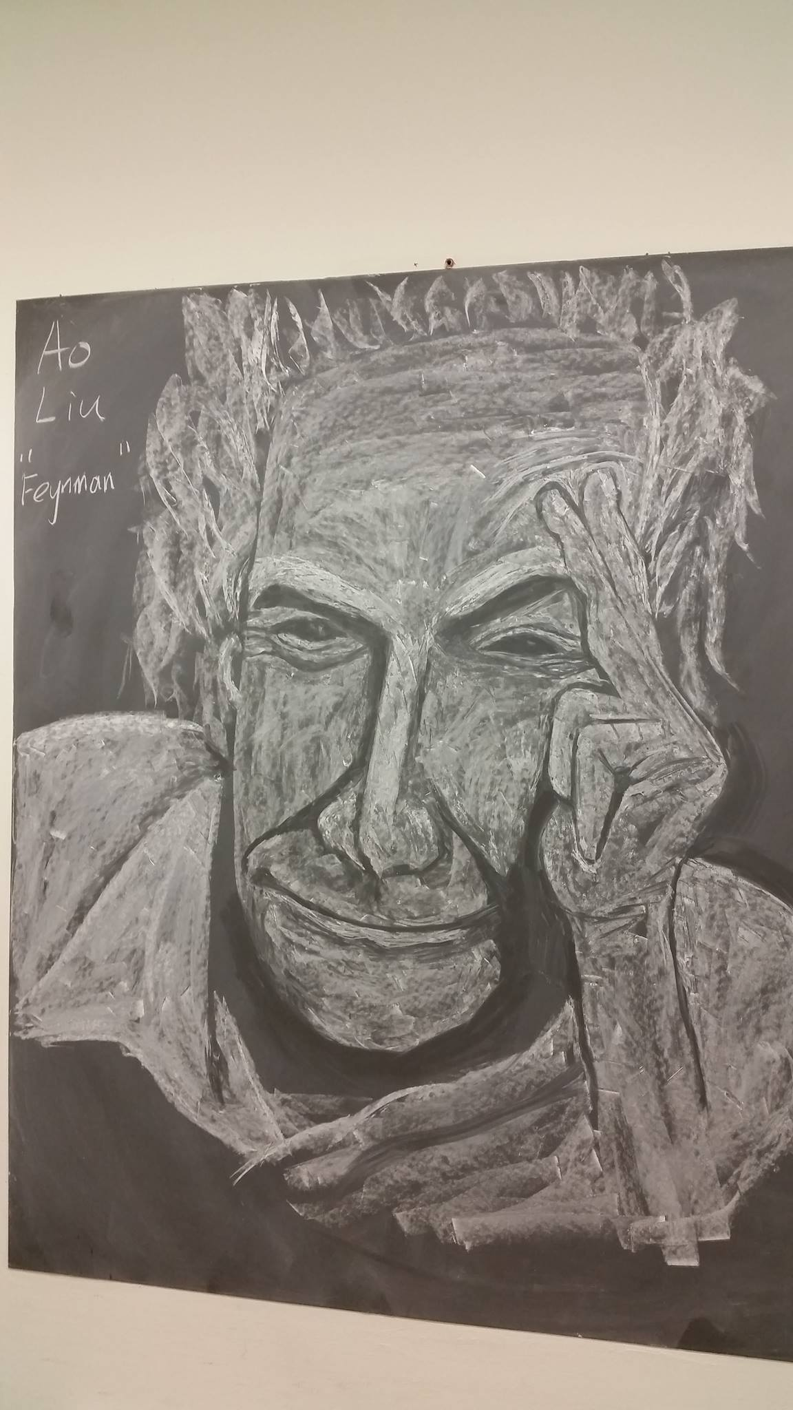 Fermilab guest scientist Ao Liu created this chalk portrait of Richard Feynman, which you can see on the 13th floor of Wilson Hall at 1321. Feynman is displayed next to a drawing of Einstein. Liu started the project for fun, but now hopes that the portraits (they are looking at us!) will inspire and motivate us to be creative and productive. Drawing: Ao Liu, AD
