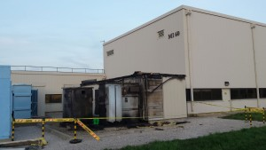 Fueled by mineral oil located inside the transformer, the fire damaged the exterior of a utility building and a power-supply system. Photo: Fermilab