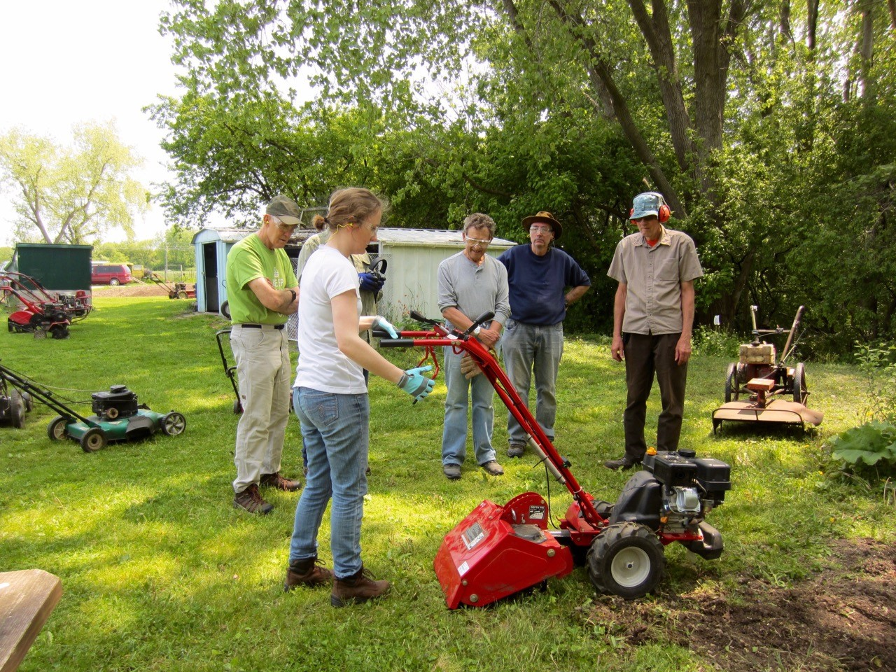 The Fermilab Garden Club members are be trained in the proper use of the rototillers and mowers. The gardens are coming back to life, with blossoms on the strawberries and the first planting of Swiss chard and lettuce. Photo: Georgia Schwender, OC