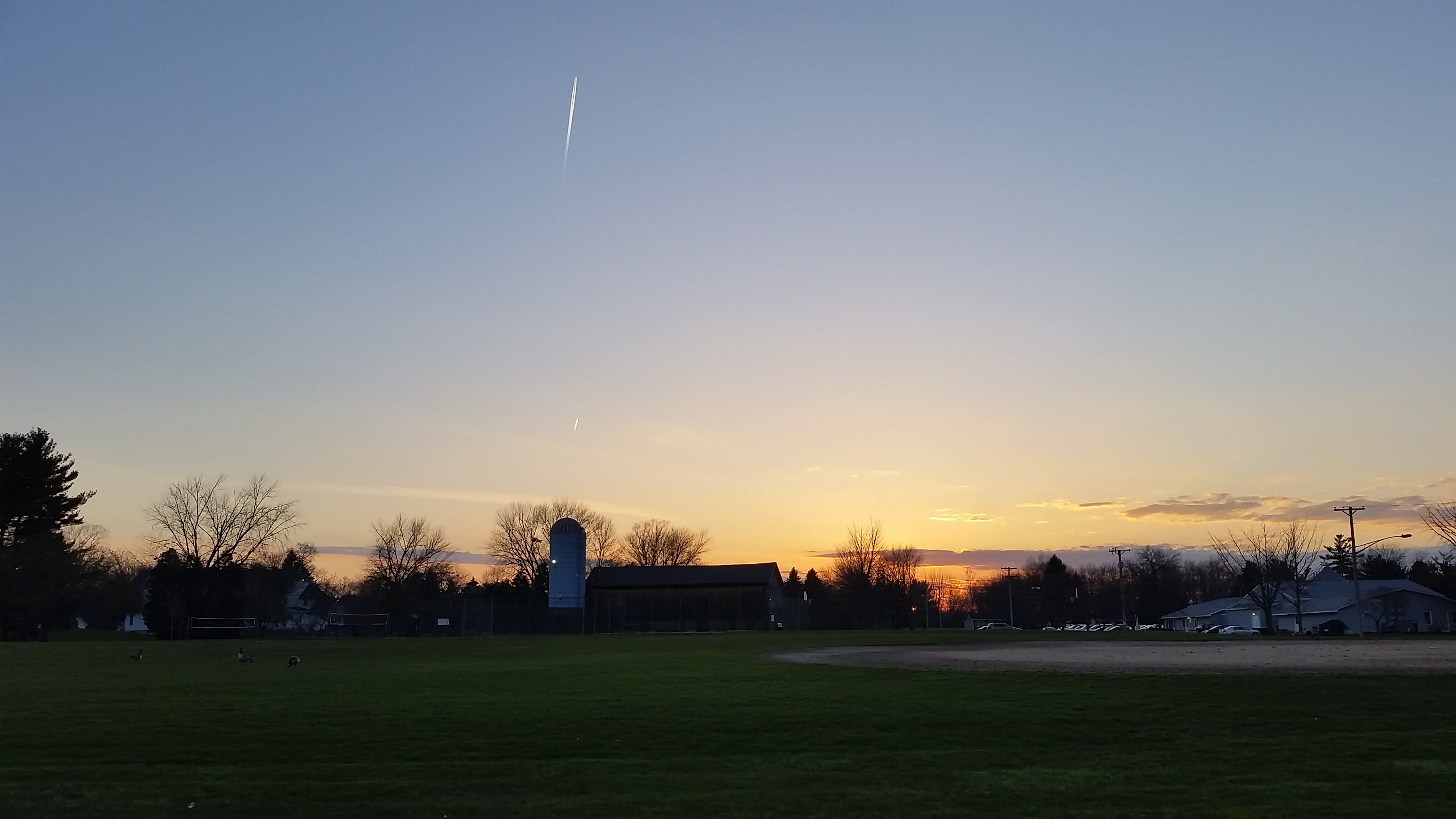 The sun sets on a gorgeous evening in the Fermilab Village. Photo: Josh O'Connell, AD
