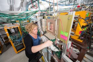 Jen Raaf works on the readout plane of a neutrino detector. Photo: Reidar Hahn