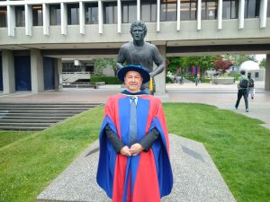In front of statue of SFU graduate Terry Fox, icon of Canada's determination. Photo courtesy of Nigel Lockyer.