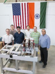 They stand by their work: PIP-II collaborators stand next to the doublet magnet, built by BARC, for the PIP-II medium-energy beam transport. From left: Michael Tartaglia (Fermilab), Joseph DiMarco (Fermilab), Vikas Teotia (BARC), Alexander Shemyakin (Fermilab), Curtis Baffes (Fermilab), Shekhar Mishra (Fermilab). Photo: Reidar Hahn