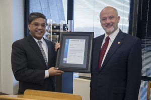 Fermilab Director Pier Oddone (right) accepts the ISO 20000 certificate from UL DQS CEO Ganesh Rao on Feb. 13 at Fermilab. Photo: Fermilab