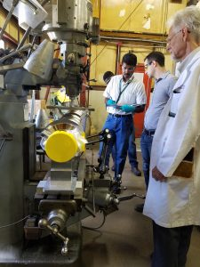 From left: Engineer Saravan Chandrasekaran, scientist Sam Posen and physicist A. Curtis Crawford calculate the deflection of an SRF cavity using a Bridgeport mill in the Village Machine Shop. Photo: Damon Bice