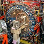 """The CDF detector, about the size of a 3-story house, weighs about 6,000 tons. Its subsystems record the """"debris"""" emerging from each high-energy proton-antiproton collision produced by the Tevatron. The detector records the path, energy and charge of the particles emerging from the collisions. This information can be used to look for particles emerging from the decay of a short-lived Higgs particle."""