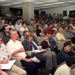 Fermilab physicists packed a lecture hall at the laboratory to hear DONUT spokesman Byron Lundberg announce the first direct evidence for the tau neutrino at a colloquium on Friday afternoon, July 21, 2000.