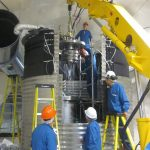 Scientists install the COUPP-60 detector a mile and a half underground at SNOLAB in Ontario, Canada. Photo: Fermilab