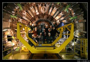After inserting the tracker, the team gathers around the detector. Image courtesy of J.F. Fuchs.