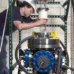 Physicist Andrew Sonnenschein works on the COUPP detector. Credit: Fermilab