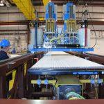 Technicians glue modules using a machine developed at Argonne National Laboratory. Photo: William Miller, NOvA installation manager