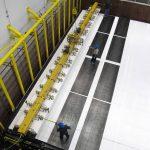Technicians add modules to the first block of the NOvA detector. Photo: Ron Williams, NOvA lead foreman