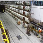 The 53-foot-tall pivoter machine, developed at Fermi National Accelerator Laboratory, will move the first block of the NOvA detector carefully down the 300-foot detector hall. Photo: Ron Williams, NOvA lead foreman