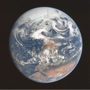 """This is the """"blue marble"""" photograph in its original orientation. With this orientation, rotation is from the right of the photo to the left; with a northerner's perspective you would see rotation from left to right."""