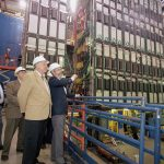 Gerald Blazey (right), physics professor at Northern Illinois University and cospokesperson of the DZero collaboration, with NIU Chancellor John Peters (middle) while touring the DZero experiment.