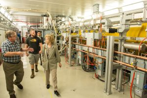 College of DuPage President Ann Rondeau, front, tours the Fermilab Accelerator Science and Technology Facility. Photo: Jim Shultz