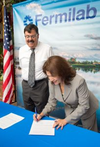 South Dakota Lieutenant Governor Matt Michels and Illinois Lieutenant Governor Evelyn Sanguinetti sign a proclamation declaring their joint support for the Long Baseline Neutrino Facility and the Deep Underground Neutrino Experiment.
