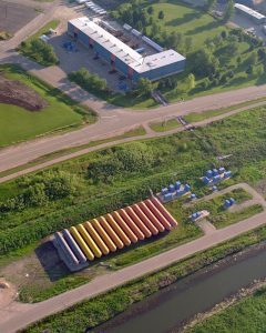 This aerial shot shows the L-shaped Central Helium Liquefier building. The row of orange tanks store helium gas and are known by the CHL crew as the tank farm. Photo: Reidar Hahn