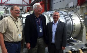 Fermilab scientist Rich Stanek, DOE Office of High Energy Physics Director Jim Siegrist and Fermilab Director Nigel Lockyer stand by the BARC-fabricated feedcap and endcap. Photo: Shekhar Mishra, AD
