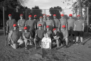 """The Final Force are this year's softball champs. Thanks go to Dan Johnson, AD, for providing the """"old red hats"""" in honor of Bob Kingsley, a founding and long-time teammate who recently passed. Thanks also to Flat Dave for standing in for team captain Dave Hockin, ESH&Q, affectionately known as Goat Man, while he's recovering from planned surgery. Photo courtesy of Chris Greer, ESH&Q"""