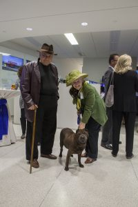 James Dean brought his two humans, Kane County Board Member Deborah Allan and her husband Arthur, to the Future of Fermilab Address and Reception. Photo: Cindy Arnold