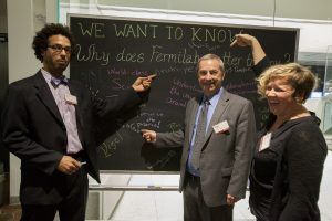 Fermilab scientist Brian Nord, Director Nigel Lockyer and scientist Jen Raaf point out notable entries on the Why Fermilab Matters board. Photo: Cindy Arnold