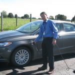 Genfa Wu charges his Ford Fusion.