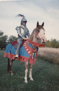 Horses have been a notable part of Fermilab's history. On Sept. 19, 1986, as part of a labwide party, then-director Leon Lederman inspired fellow physicists on the noble quest for knowledge by donning a knight's suit of armor and ascending the stairs in front of Wilson Hall on his horse Cody. Photo courtesy of Ellen Lederman