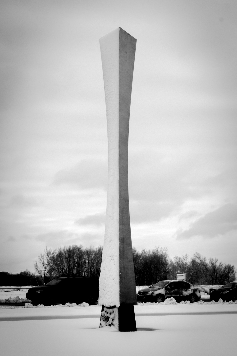Last week's snow whitened exactly one side of the obelisk in front of Wilson Hall. Photo: Jesus Orduna, Rice University