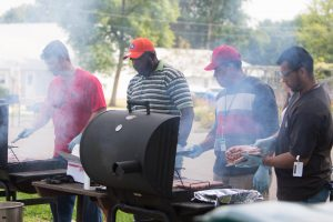 From left: Mike Jeeninga, Brent Sylvester, Darrell Frye and Armando Barboza (all of TD) cook meat on the grill for their colleagues. Photo: Tom Nicol, TD