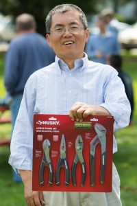 Yuenian Huang, TD, was one of this year's raffle winners. He won a four-piece pliers set. Photo: Tom Nicol, TD