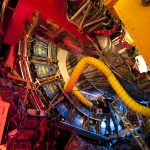 The three-story, 6,000-ton CDF detector takes snapshots of the particles that emerge when protons and antiprotons collide.