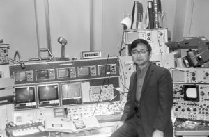 Ryuji Yamada is one of the scientists who, in 1972, helped the Main Ring accelerator achieve 100 and up to 200 billion electronvolts. In this picture, 100 billion electronvolts is indicated in the meter just above the controls. Photo: Fermilab