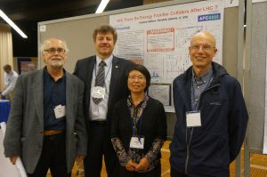 Fermilab represent! Fermilab scientists David Nueffer, Vladimir Shiltsev, Meiqin Xiao and Greg Saewert can tell you about the colliders of the future, as Shiltsev's poster does so nicely. Photo courtesy of Vladimir Shiltsev