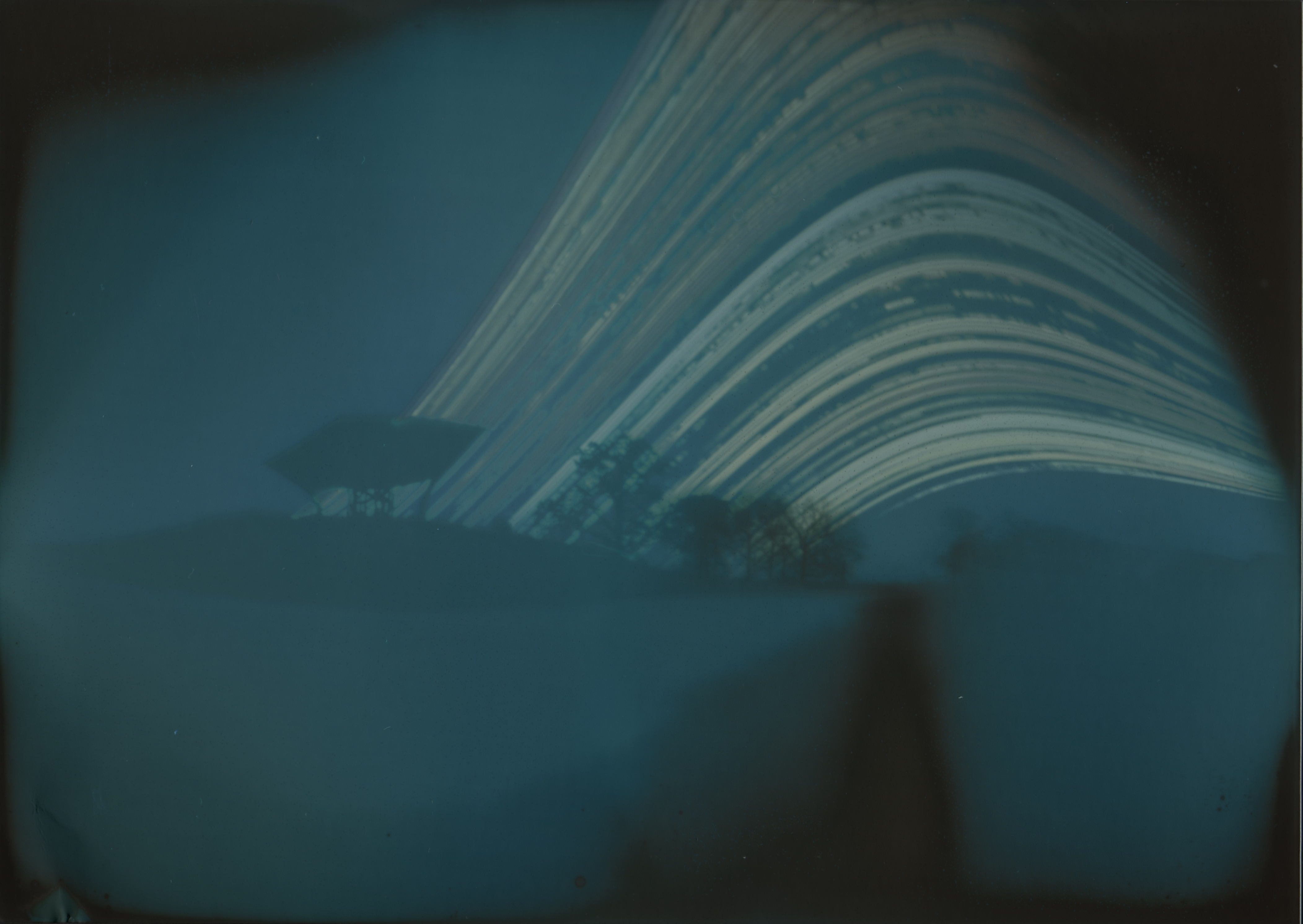 This image of the Proton Pagoda is a five-month-long exposure taken with a pinhole camera made from an aluminum can and a sheet of photo paper. It was taken from June to November and shows the sun's path every day in that period. Photo: Greg Derylo