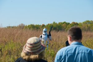 "An imperial stormtrooper stands in the Fermilab prairie while filming scenes for unofficial fan-film ""Star Wars: Forgotten Realm."""
