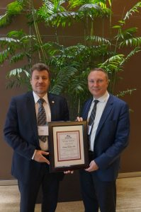 Vladimir Shiltsev, left, was presented with the 2016 George Gamow Award by the Russian-American Science Association. On right is Igor Efimov, department chair of biomedical engineering at George Washington University, RASA president and the 2015 recipient of the Gamow Award.